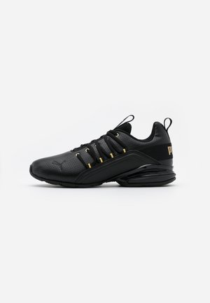 AXELION - Zapatillas de entrenamiento - black/team gold