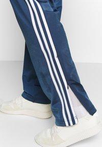 adidas Originals - FIREBIRD ADICOLOR TRACK PANTS - Träningsbyxor - marine - 3