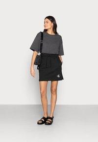 Calvin Klein Jeans - MONOGRAM HEAVYWEIGHT SKIRT - Mini skirt - black - 1