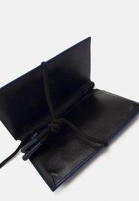 Marni - MUSEO SOFT MINI UNISEX - Across body bag - black/navy blue - 6