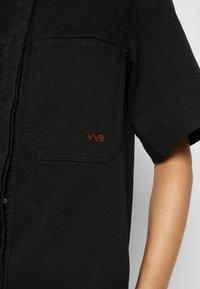 Victoria Victoria Beckham - FRAYED HEM MINI DRESS - Denim dress - black - 7