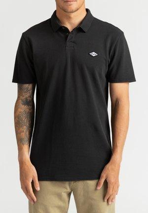 SKOOLED  - Polo shirt - black