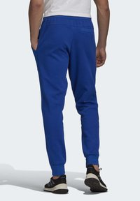 adidas Performance - MUST HAVES STADIUM TRACKSUIT BOTTOMS - Pantalones - blue - 1