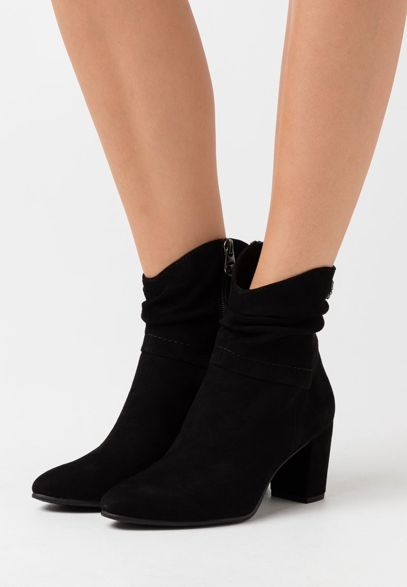 Marco Tozzi by Guido Maria Kretschmer - Classic ankle boots - black