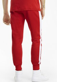 Puma - ICONIC - Tracksuit bottoms - high risk red - 1