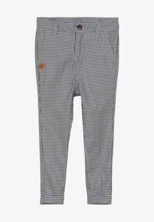 VARTUS TROUSERS - Trousers - black/white