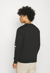 Calvin Klein Jeans - URBAN GRAPHIC LOGO CREW NECK UNISEX - Collegepaita - black - 2