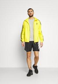 adidas Performance - BASIC 3 STRIPES WINDBREAKER - Outdoorjacka - yellow - 1