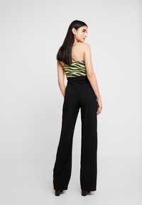 Missguided - STRETCH EYELET WIDE LEG TROUSER - Trousers - black - 2
