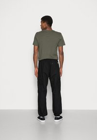 Carhartt WIP - JOGGER COLUMBIA - Cargo trousers - black rinsed - 2