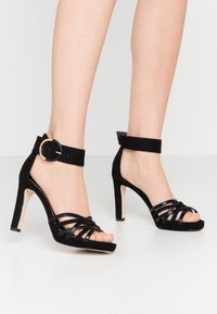 Tamaris - High heeled sandals - black - 0