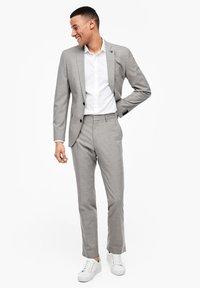 s.Oliver BLACK LABEL - Suit trousers - brown melange - 1