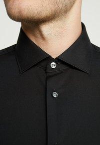 Tommy Hilfiger Tailored - CLASSIC SLIM  - Formal shirt - black - 6
