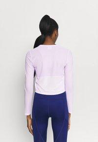 Puma - TRAIN LONG SLEEVE - Maglietta a manica lunga - light lavender - 2