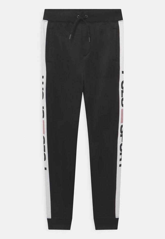 Teplákové kalhoty - polo black