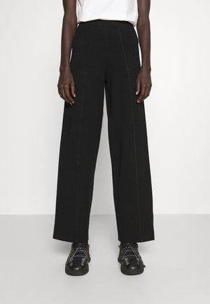 LIEN - Trousers - black
