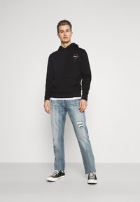 Tommy Hilfiger - CIRCLE CHEST HOODY - Felpa con cappuccio - black - 1