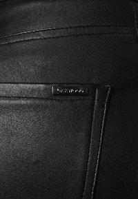 Oakwood - P ANDORA - Leather trousers - black - 6