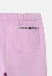 Calvin Klein Jeans - RELAXED ELASTIC  - Tracksuit bottoms - purple - 2