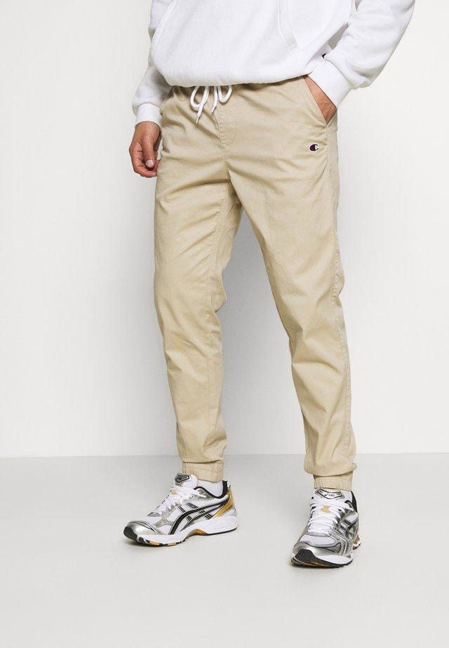 ELASTIC CUFF PANTS - Teplákové kalhoty - beige