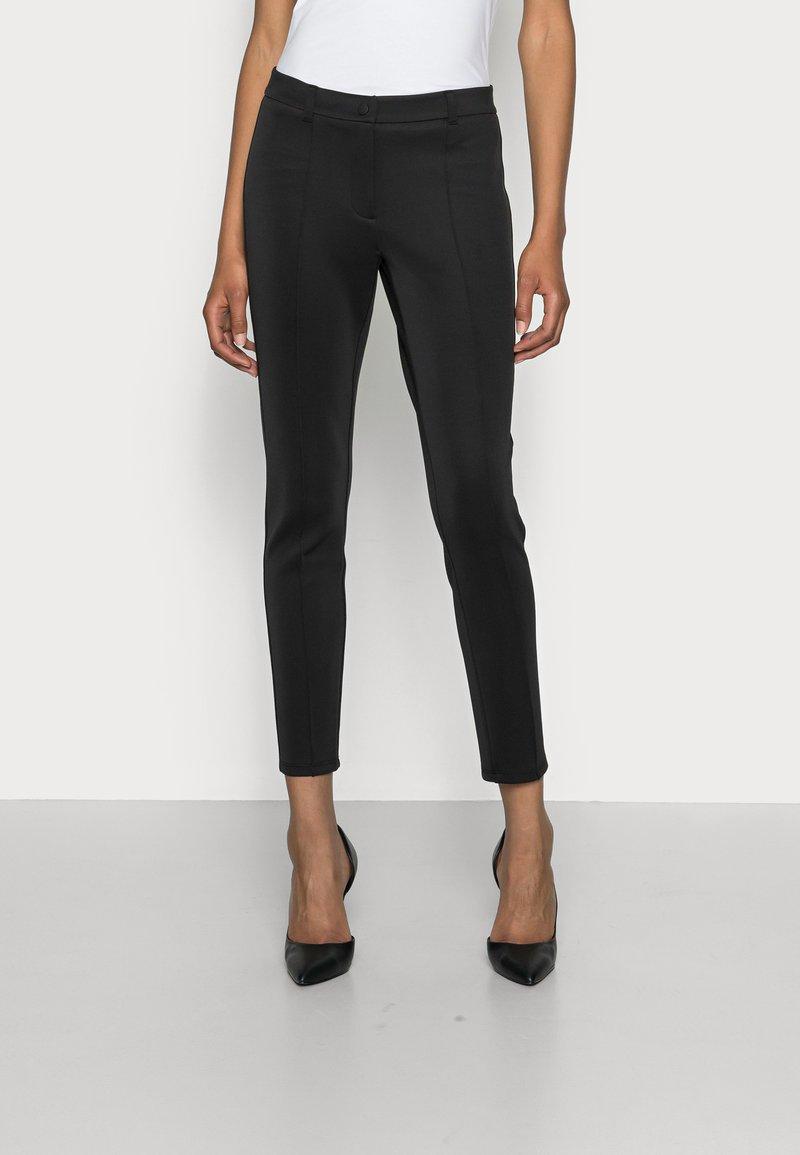someday. - CARANA - Trousers - black