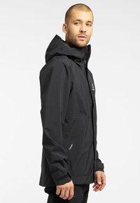 Haglöfs - TJÄRN JACKET  - Hardshell jacket - true black - 4
