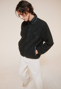 adidas Originals - ZIP THRU - Fleece jacket - black - 1