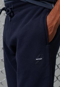 Superdry - Tracksuit bottoms - deep navy - 0