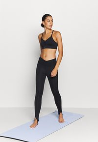Nike Performance - YOGA CORE CUTOUT 7/8 - Leggings - black/dark smoke grey - 1