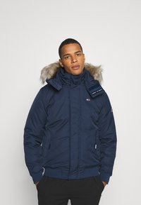 Tommy Jeans - TECH BOMBER UNISEX - Winter jacket - twilight navy - 0