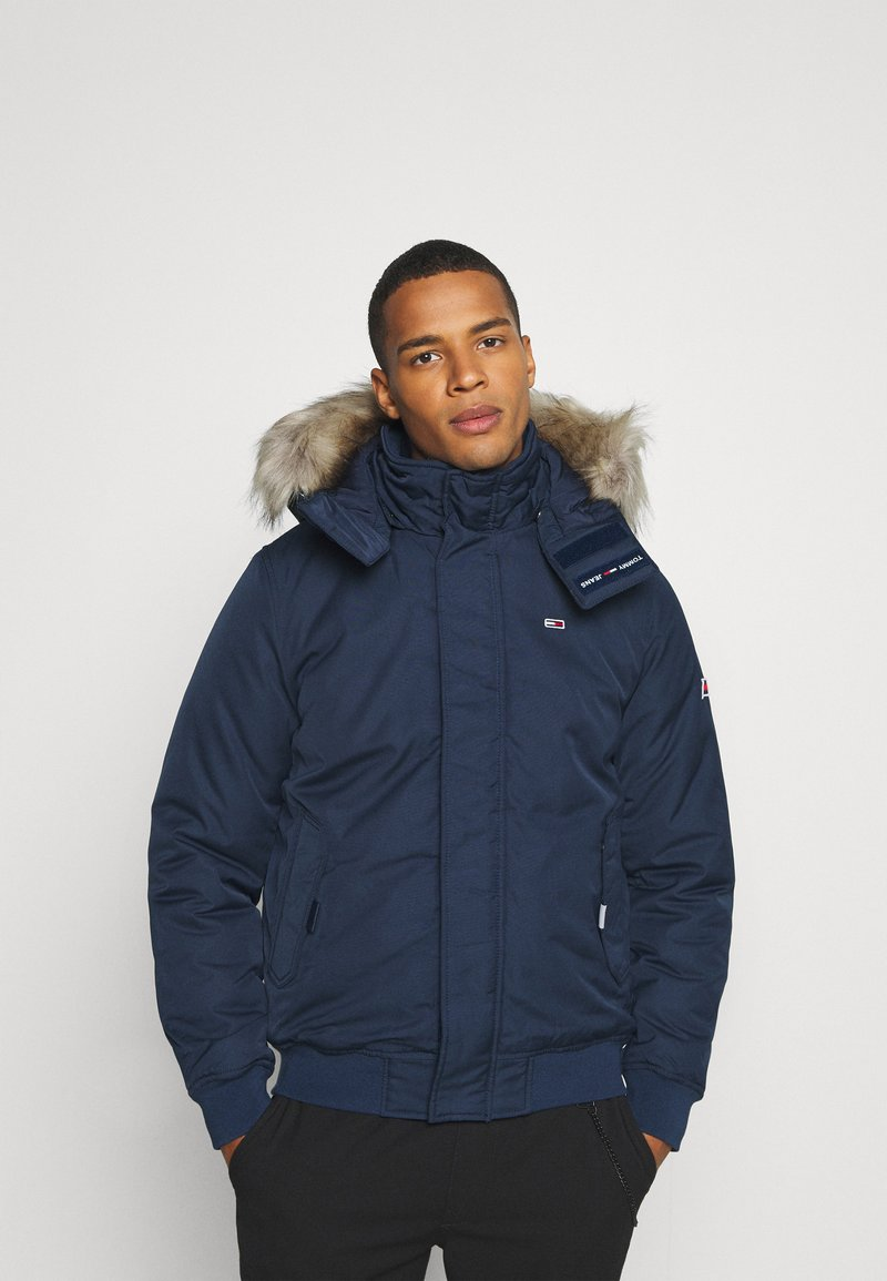 Tommy Jeans - TECH BOMBER UNISEX - Winter jacket - twilight navy