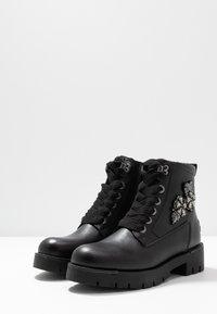 JETTE - Platform ankle boots - black - 4