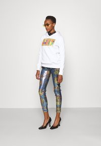 Versace Jeans Couture - PANTS - Leggings - Trousers - blue - 1