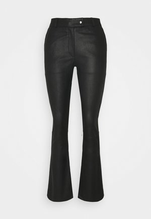 CHINO - Leather trousers - black