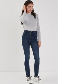 Cache Cache - MIT HOHER TAILLE - Slim fit jeans - denim blue black - 1