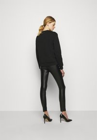 KARL LAGERFELD - METALLIC STRETCH - Leggings - Trousers - black - 4