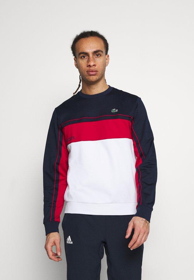 TENNIS - Sweatshirt - navy blue/ruby white