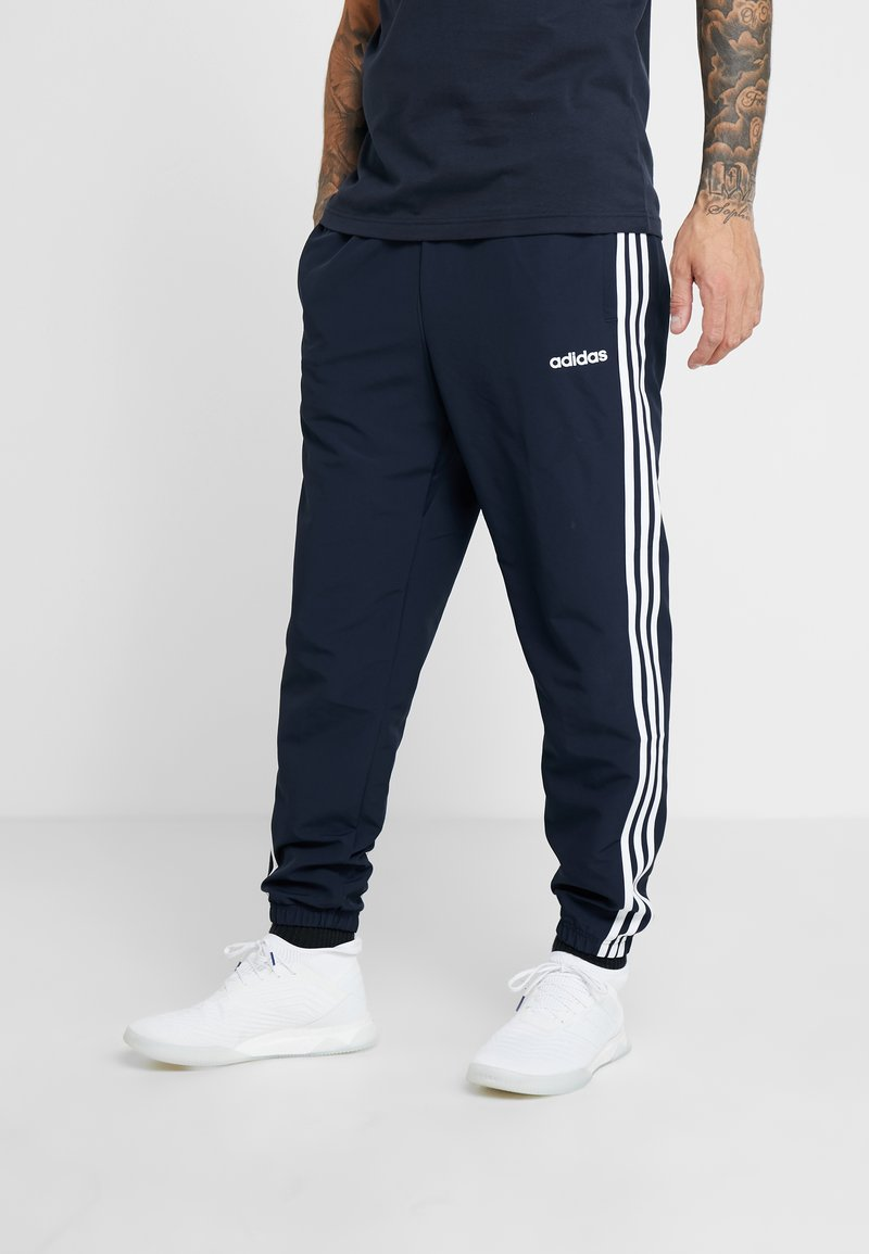 adidas Performance - WIND - Tracksuit bottoms - blue