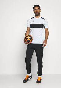 Nike Performance - DRY ACADEMY PANT - Pantaloni sportivi - black/white - 1