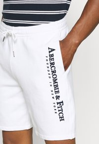 Abercrombie & Fitch - TECH LOGO - Tracksuit bottoms - white - 3