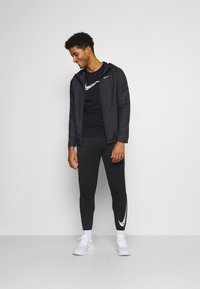Nike Performance - BREATHE RUN  - T-shirts print - black/white - 1