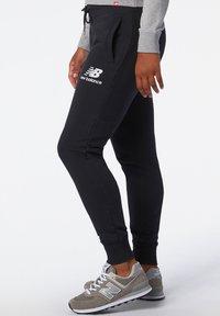 New Balance - Tracksuit bottoms - black - 2