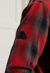 Superdry - EVEREST STORM - Zip-up hoodie - red ombre - 3