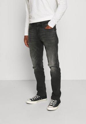 RIDGE - Straight leg jeans - black