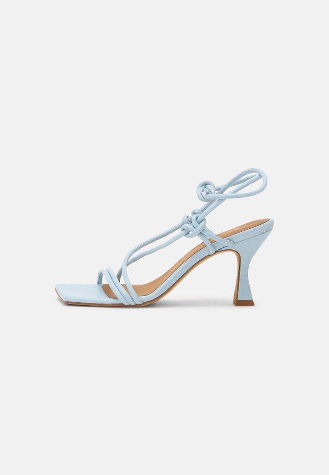 Sandales - seta celeste