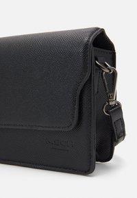 Moss Copenhagen - NADIMA CROSSOVER BAG - Across body bag - black - 3