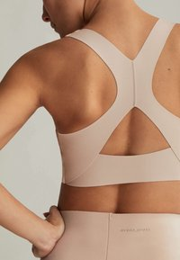 OYSHO - Medium support sports bra - beige - 3