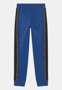 Calvin Klein Jeans - COLOUR BLOCK  - Pantalones deportivos - blue - 1