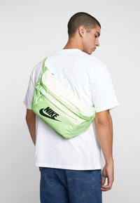 Nike Sportswear - TECH HIP PACK - Bum bag - barely volt/black - 1