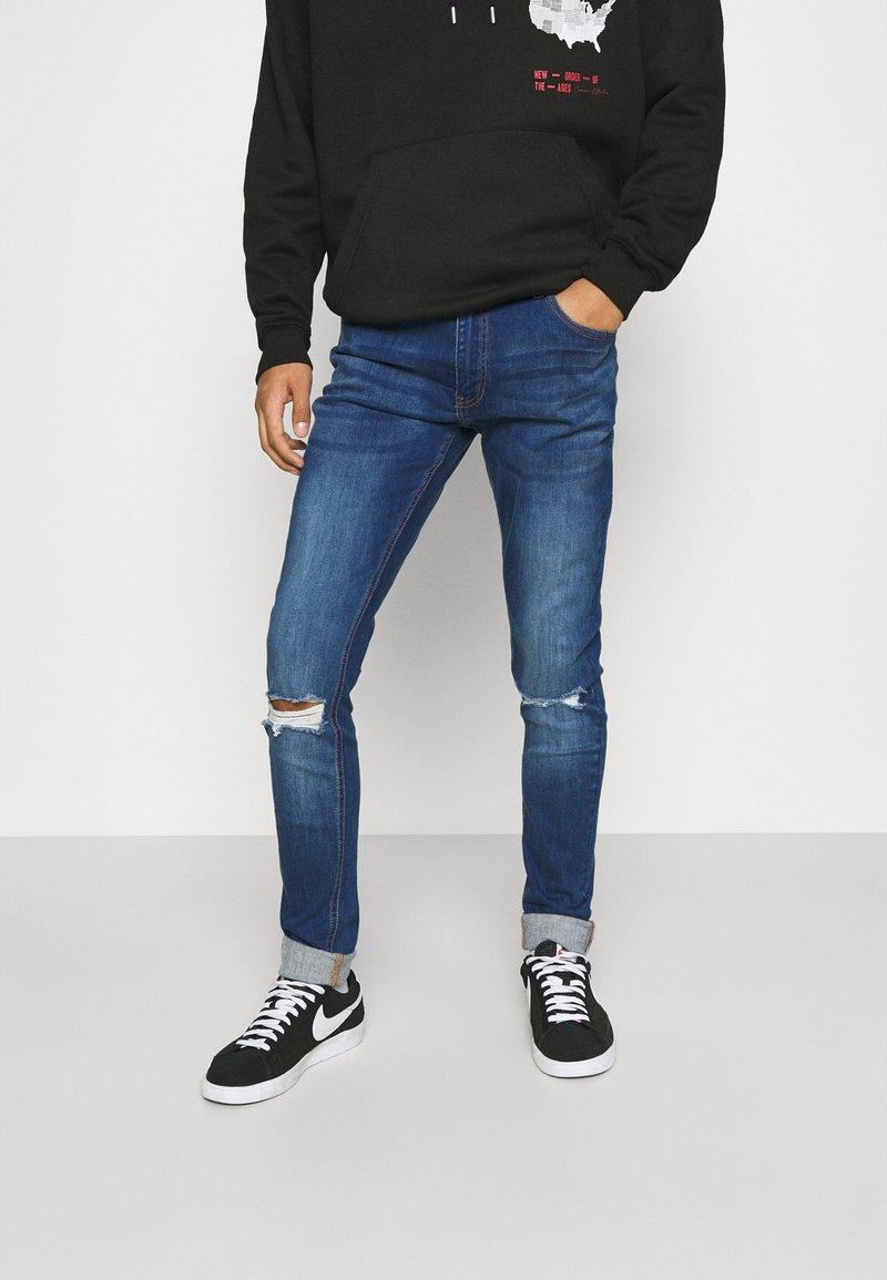 CLOSURE London - RIPPED SLIM FIT  - Slim fit jeans - blue